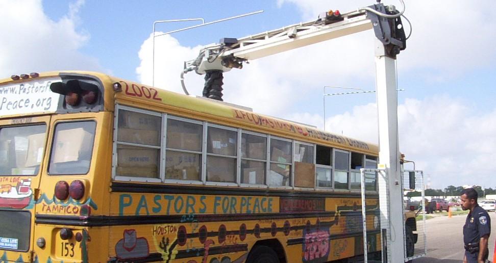 Pastors for Peace Friendshipment Caravan vehicle being inspected at the Pharr International Bridge in Texas.